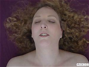 Curly damsel massages her joy button