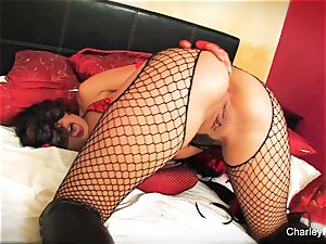 Dolled up Charley chase plays with her labia