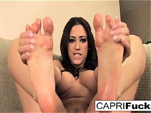 Capri plays with her honeypot and soles