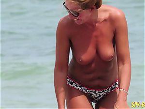 bare-breasted first-timer mummies - hidden cam Beach Close-Up