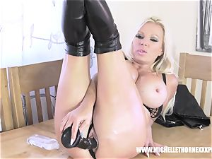 Oily ash-blonde biker babe strokes with a meaty dark-hued plaything