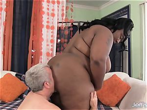 big dark-hued woman takes meaty rod