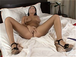 Pierced japanese London Keyes plays with her fuckbox in couch