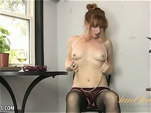 Amber Dawn delectations herself wearing thigh highs.