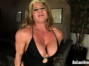 two muscled dolls display off finger and dildo