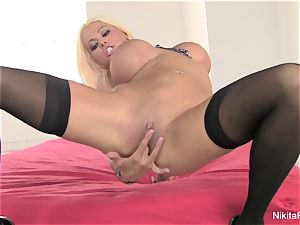 Russian milf Nikita frigs her cock-squeezing snatch